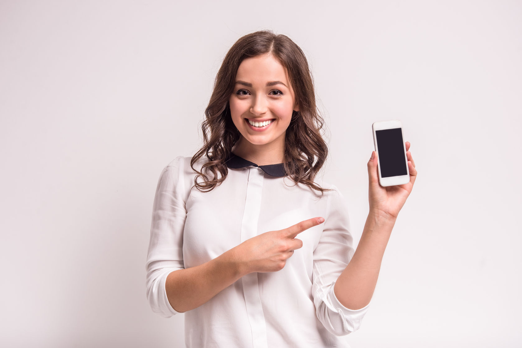 Social worker holding mobile device
